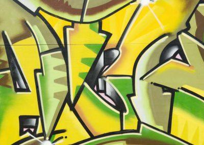Graffiti with Green & Yellow Arrows